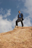 Business anywhere. Man standing in the desert with his brief case Stock Photo