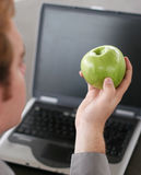 Business apple. Business man going to take a bite of his apple Stock Photo