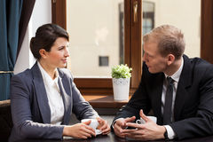 Business appointment in coffeehouse. Office workers having business appointment in coffeehouse Stock Photo