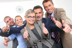 Business approval - Young colleagues. Successful business people in office Stock Photo