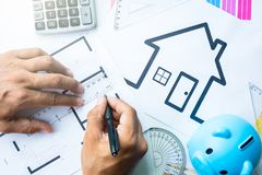 Business, architecture, building, construction concept - close up of architect working on blueprint . royalty free stock photography
