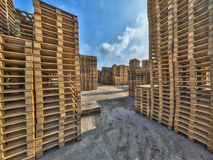 Business area with huge piles of euro cargo pallets Royalty Free Stock Photo