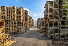 Business area with huge piles of cargo pallets Royalty Free Stock Image