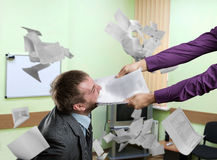 Business argument. Businessman is biting a contract stock image