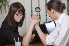 Business arm wrestling in office royalty free stock photography