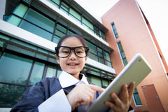 Business Asian child using tablet Stock Image