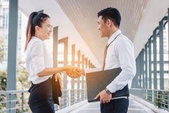 Business asian people standing at building walkway shaking hands Royalty Free Stock Photo