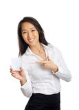 Business Asian Woman pointing blank paper. Business Asian woman pointing blank business card Royalty Free Stock Image