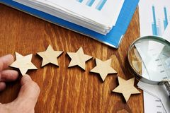 Business assessment rate. Five stars and financial report. Business assessment rate concept. Five stars and financial report stock photography