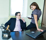Business assistant flirting with  boss Royalty Free Stock Photo