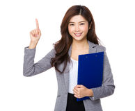 Business assistant hold with file pad and finger point up Royalty Free Stock Images