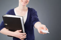 Business Assistant Passing a Business Card Stock Image