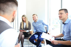 Business associates discussing new project. Plan in modern office Royalty Free Stock Image