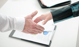 Business associates getting ready to shake hands Stock Image