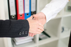 Business associates getting ready to shake hands. In office Stock Photography