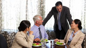 Business associates having a working lunch Royalty Free Stock Photos