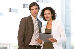 Business associates planning new strategy. And looking at the camera Royalty Free Stock Photo