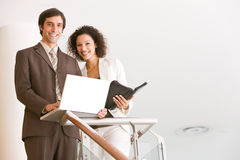 Business associates planning new strategy. Looking at the camera Royalty Free Stock Photo