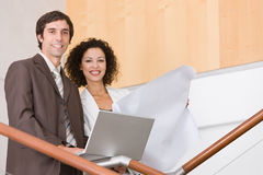 Business associates planning new strategy. Business associates discussing and planning new strategy Stock Image