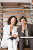 Business associates planning new strategy. Business associates sitting and planning new strategy Royalty Free Stock Images