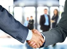 Business associates shaking hands. In office Royalty Free Stock Photos