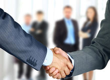 Business associates. Shaking hands in office Stock Photos