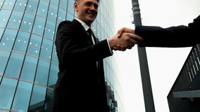 Business associates shaking hands stock footage
