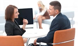 Business associates talking at a Desk. Photo with copy space Stock Photos
