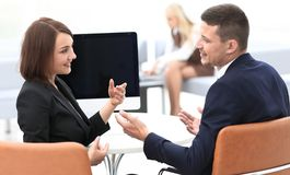 Business associates talking at a Desk. Photo with copy space Royalty Free Stock Photo