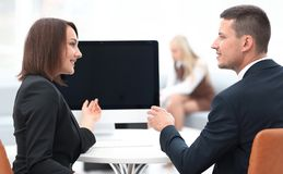 Business associates talking at a Desk. Photo with copy space Royalty Free Stock Images