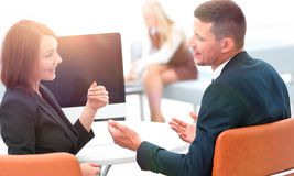 Business associates talking at a Desk. Photo with copy space Stock Images