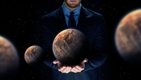 Close up of businessman with planet hologram Stock Image