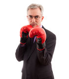Business attack. Business man in boxing gloves first punch Stock Image