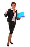 Business attitude. Attractive business woman with documents shows alright gesture on white background Stock Photo