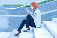 Business attractive woman reading carefully tablet Stock Photos