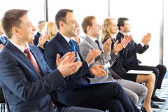 Business audience applaud at training stock photos