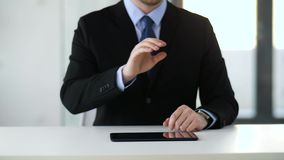 Businessman working with tablet pc. Business, augmented reality and future technology concept - businessman working with tablet pc computer and something stock video