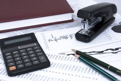 Business background. With calculator and diagrams Royalty Free Stock Image