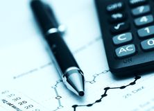 Business background. Calculator, pen and business report Royalty Free Stock Images
