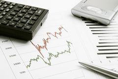 Business background. With finance graphs, pen, calculator and PDA Stock Photography