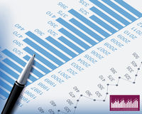 Business background. S graphs and stationary pen Stock Photography