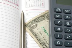 Business background. With banknote, pen and calculator Stock Photos