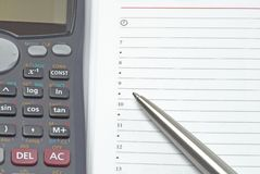 Business background. With pen and calculator Royalty Free Stock Photos