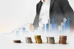 Business background blur of asian aged 40 to wearing a black suit and graphs,statistics. Foreground is foreign currency . Stock Image
