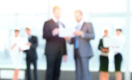 Business background.blurred image of business people standing in office. Stock Photography