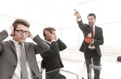 Business background.employees listen to their boss stock image