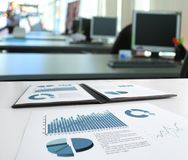 Business report and documents statistics on the office workplace