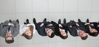 View from the top.business team looking up. Business background. business team looking up Stock Photos