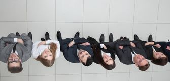 View from the top.business team looking up. Business background. business team looking up Stock Photo