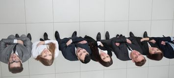 View from the top.business team looking up. Business background. business team looking up Stock Image